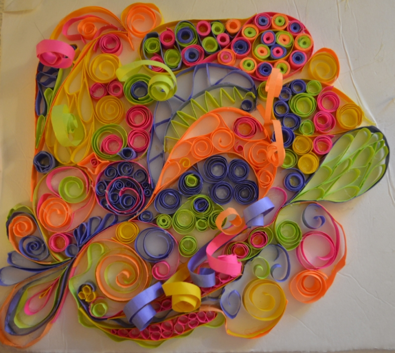 3D Art. Pastel colored paper in different spiral shapes.