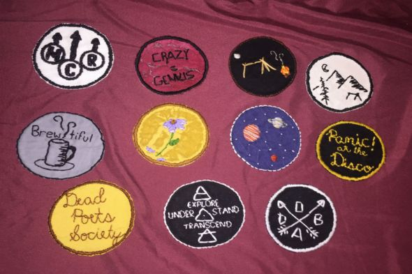 array of patches on maroon background