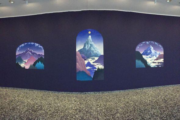 sunrises over mountains on purple wall
