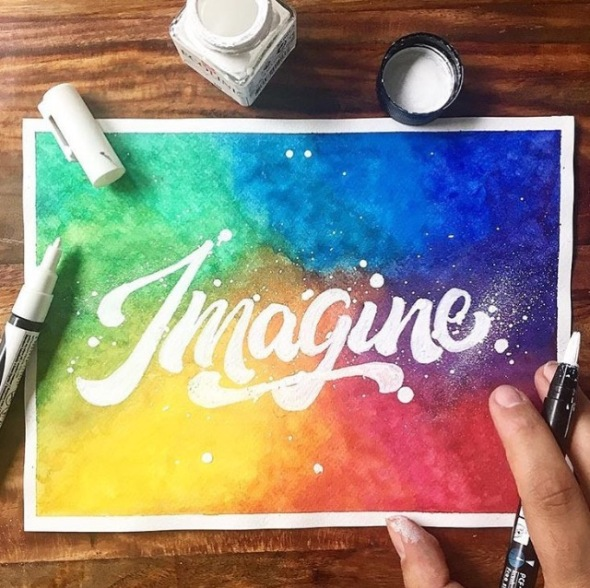 Imagine with rainbow watercolor background