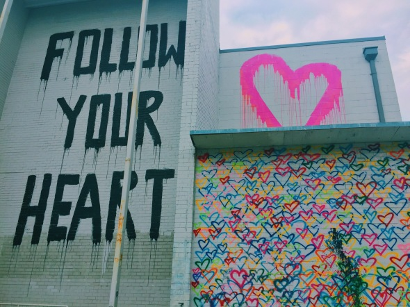 follow your heart and rainbow hearts mural