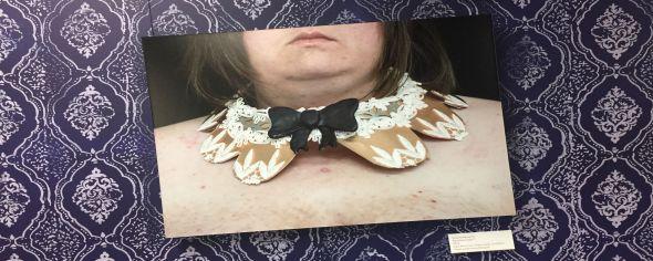 Women wearing a metal collar