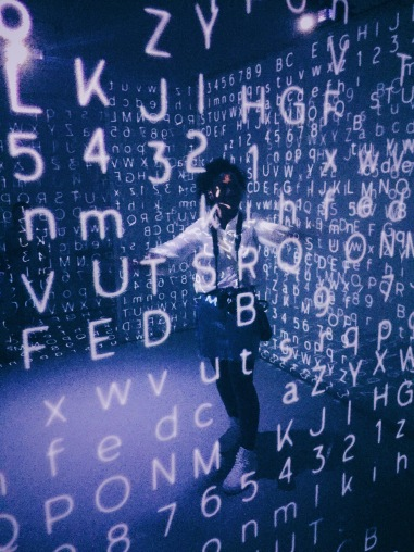 person surrounded by floating letters
