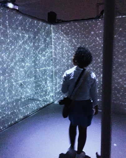 person looking at a wall of lights