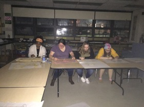 Club members working in the dark