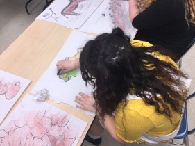 Club member Mia Kissinger working on her cave art