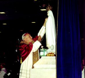 Saint Pope John Paul II with statue of Our Lady of Fatima
